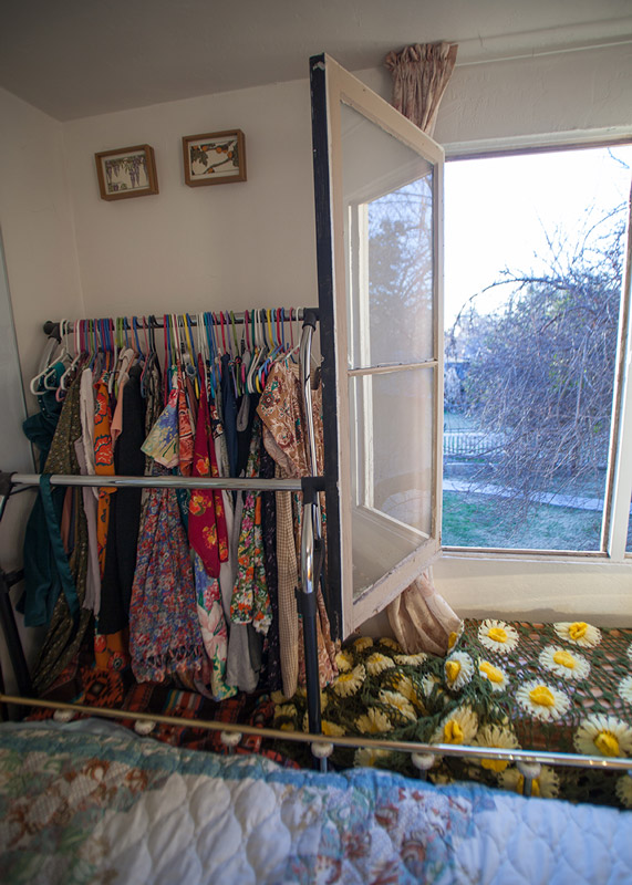 clothes rack by open window