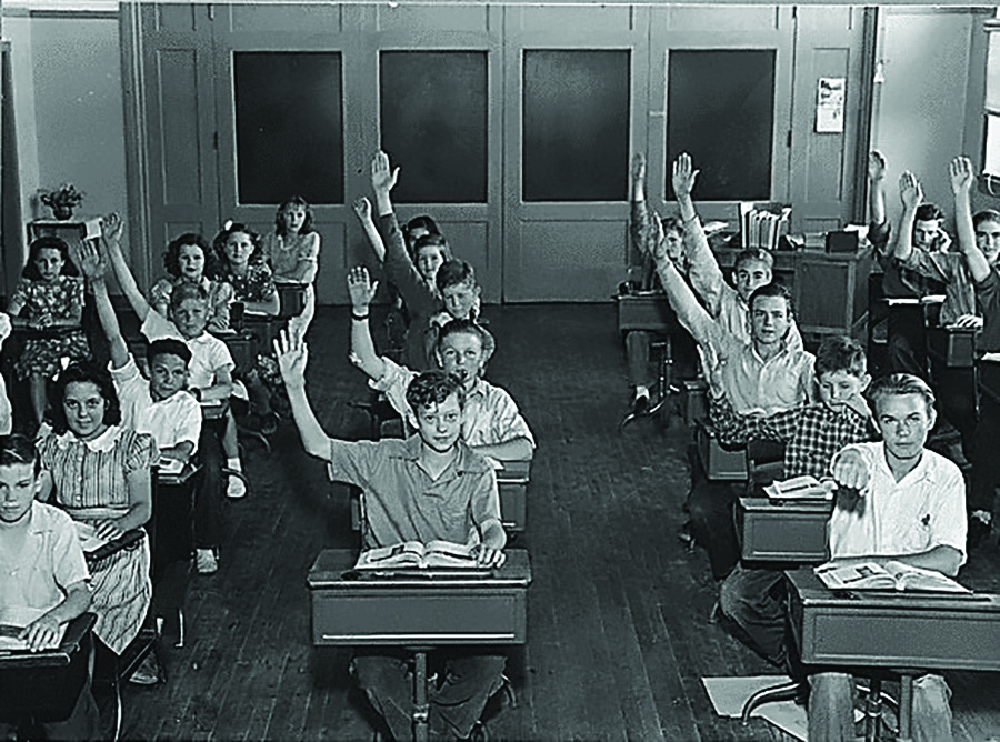 Grayson School kids raise their hands when asked whose parents had come to California since 1930.